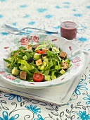 Lettuce, seitan, tomato and olive salad with beetroot salad