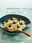 Grated apple and carrot salad with coconut milk gelatine squares topped with truffles