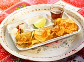 Aperitif tray with saffron-flavored crisps