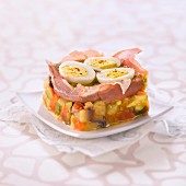 Ratatouille with raw ham,hard-boiled quail's eggs and pesto jelly