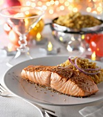 Spicy piece of salmon with orange lentils