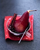 Spicy red wine poached pear
