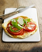 Omelette-pizza with tomatoes