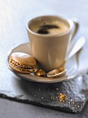 Cup of expresso with a coffee macaroon