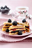 Club sandwich-style french toast with rose and blackberry jam