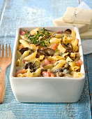 Pasta, eggplant and Morbier cheese-topped dish