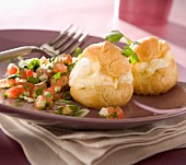 Cheese cream puffs with tomato and herb salad