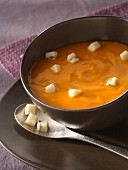 Cream of pumpkin soup with diced Morbier