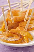 Sliced pineapple and mango roasted a la plancha