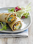 Rolled buckwheat galette with carrot and spinach filling
