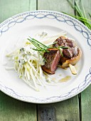 Veal steak and celeriac-pear salad with roquefort sauce