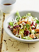 Mixed salad with shrimps and pomegranate