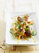 Curried chicken brochettes with crisp vegetable salad