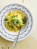 Casarecce with saffron cream and baby spinach shoots