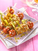 Tofu and cherry tomato brochettes with sesame seeds and soya sauce