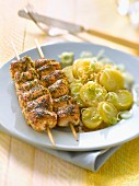 Oriental -style marinated chicken brochettes with Ratte potato salad
