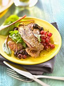 Sliced duck breast with summer fruit and baby beetroot shoots