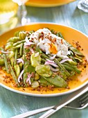 Pan-fried fava beans,sugar peas and green beans with a poached egg and breadcrumbs