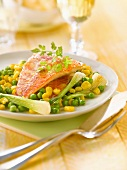 Pan-fried red mullet fillets with peas,sweet corn and spring onions
