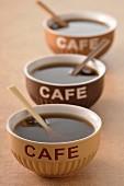 Three bowls of coffee