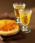Galette des rois and glasses of cider