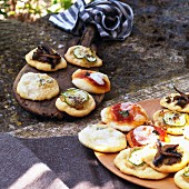 Assorted mini pizzas for an aperitif