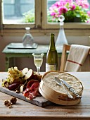 Mont d'Or cheese with cold cuts,fruit and white wine
