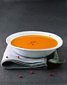 Cream of pumpkin soup with pink pepper