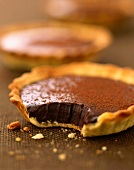 Chocolate tartlets with a bite missing