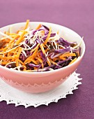 Grated carrot, red cabbage and celeriac salad with raisins