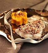 White fish fillet with a hazelnut crust and carrot puree