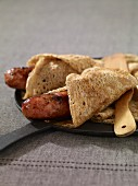 Robiquette,sausage in a buckwheat crepe