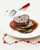 Steak with eggplants and peeled tomatoes