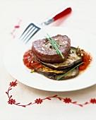 Steak with eggplants and peeled tomatoes
