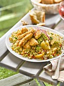 Bulghour salad with confit citrus and sliced breaded chicken breasts with sesame