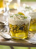 Quail's egg in aspic, crushed green olive and whipped cream with herb Verrine