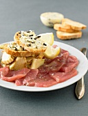 Veal carpaccio and crostinis with truffle butter