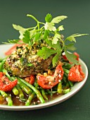 Veal coated in herbs,green beans with tomatoes