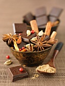 Bowl of squares of chocolate and spices