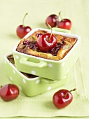 Individual cherry and pistachio batter puddings