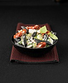 Squid ink penne with zucchinis,sun-dried tomatoes and basil