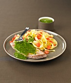 Veal escalope with pesto,tagliatelles with tomatoes