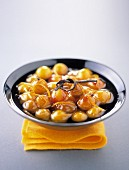 Stewed mirabelle plums with vanilla and orange zests