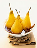 Pears poached in spicy white wine