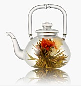 Glass teapot with tea flower