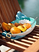 Peach and apricot brochettes outdoors