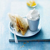 Mirabelle filo pastry turnovers with vanilla-whipped cream