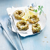 Fried squid rings coated with oatmeal and parsley