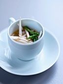 Dublin Bay prawn stock with thinly chopped mushrooms and samphire