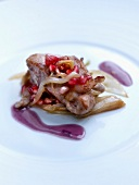 Veal with pan-fried chicory,red onion butter and pomegranate seeds